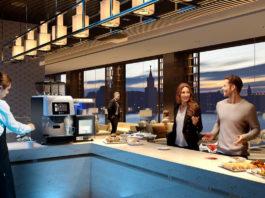 Una sala colazioni con la superautomatica Kalea Plus Necta