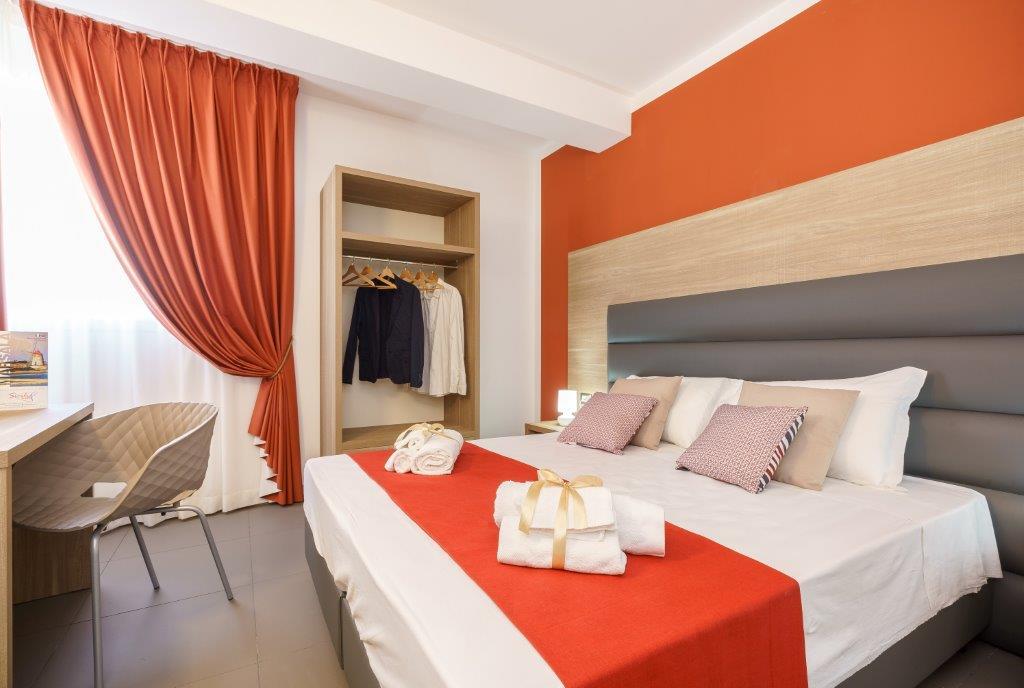 Una camera d'hotel firmata Mobilspazio