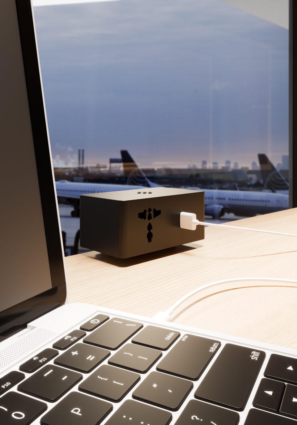 VersaQ: modulo per la ricarica dei dispositivi mobili in versione nera collegati ad un laptop